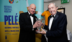 Chairman of the FWA Patrick Barclay presents the trophy to Gordon Banks on behalf of Pele, next to the National Football Museum signage advertising a new exhibition on Pele, during the Football Writers Association Tribute night at The Savoy, London. PRESS ASSOCIATION Photo. Picture date: Sunday January 21, 2018. Photo credit should read: John Walton/PA Wire