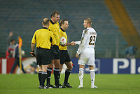 Real Madrid's David Beckham shakes hands with the giant referee Rene Temmink, and his assistants Rob Meenhuis and Roger Geutjes at the end of the match