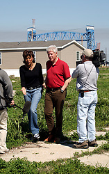 16 March 2008. New Orleans, Louisiana. Lower 9th ward.<br /> Former President Bill Clinton talks with NBC news anchor ?????. Clinton was in the area to encourage the 600 volunteers for the 'v' clean up of the neighbourhood devastated by Hurricane Katrina. The massive clean up project was organised by Brad Pitt's Make it Right Foundation aided by the Clinton Global Initiative.<br /> Photo credit; Charlie Varley.
