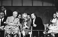 1959. On the set of the making of the musical Can Can, in Hollywood, Madame Khrushchev ( in black) trying to understand<br /> their translator sitting behind.<br /> <br /> 1959. Sur le plateau de tournage de la comédie musicale Can Can , à Hollywood, Mme Khrouchtchev (en noir) essayer de comprendre leur traducteur assis derrière .