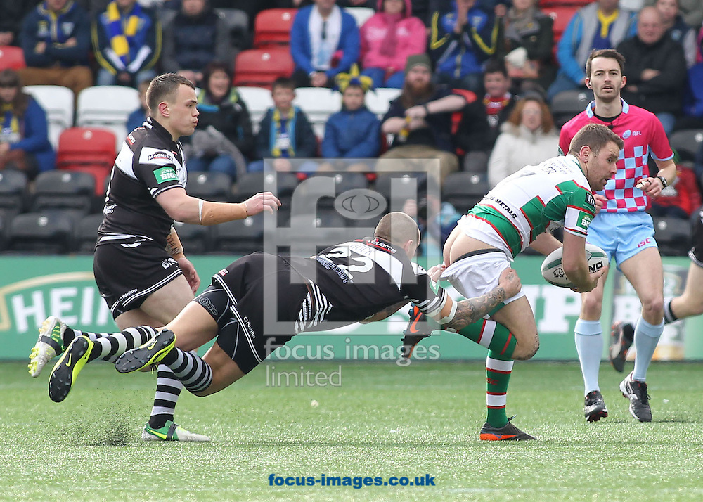 Picture by Michael Sedgwick/Focus Images Ltd +44 7900 363072.29/03/2013.Richard Myler of Warrington Wolves is tackled by Gareth Hock of Widnes Vikings during the Super League match at the Stobart Stadium Halton, Widnes.