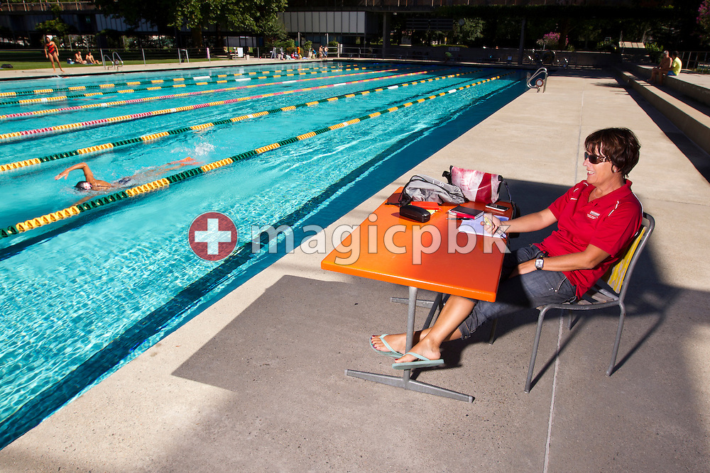 Swimmer Swann OBERSON (swimming) of Switzerland and her Swiss coach Elena Nembrini are pictured during her swim training at the outdoor swimming pool (Piscina Comunale) in Bellinzona, Switzerland, Tuesday, Aug. 9, 2011. (Photo by Patrick B. Kraemer / MAGICPBK)
