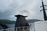 Smoke coming from the funnel of the Levante ferry on the route from Ithaca to Sami, Kefalonia, Greece. Kefalonia is an island in the Ionian Sea, west of mainland Greece.