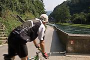 Pista ciclabile lungo il fiuma Adda a Paderno d'Adda..Bicycle path along the canal of Paderno, near the dam of Adda river.