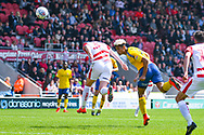 Lyle Taylor of Charlton Athletic (9) takes a shot during the EFL Sky Bet League 1 play off first leg match between Doncaster Rovers and Charlton Athletic at the Keepmoat Stadium, Doncaster, England on 12 May 2019.