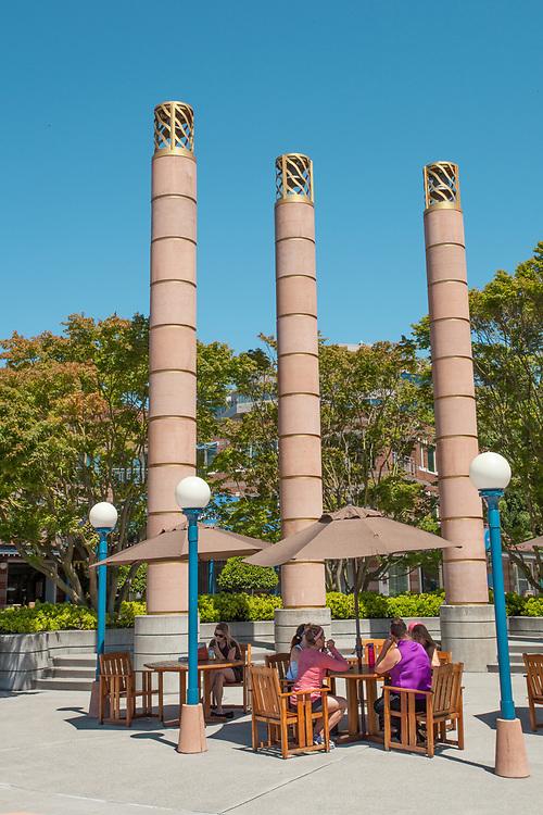North America, United States, Washington, Kirkland, Carillon Point Marina,women at table under bells