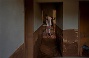 A men enters his grandmother's house in order to searching for utensils remained after the flood in Paracatu de Baixo, one of the districts of Mariana, a brazilian city in the state of Minas Gerais. On november 5th, a mining waste dam failed causing a flood of mud.