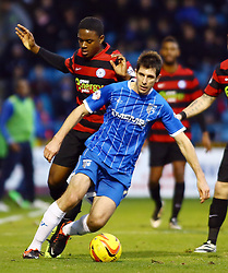 Peterborough United's Jermaine Anderson in action with Gillingham's Danny Hollands - Photo mandatory by-line: Joe Dent/JMP - Tel: Mobile: 07966 386802 14/12/2013 - SPORT - Football - Gillingham - Priestfield Stadium - Gillingham v Peterborough United - Sky Bet League One