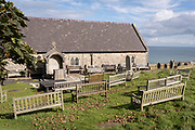 Overlooking the sea is the hilltop churchyard of Saint Tudno's Church on the Great Orme mountain, its benches facing an outdoor altar for services during the Covid pandemic lockdown, on 4th October 2021, in Llandudno, Gwynedd, Wales.