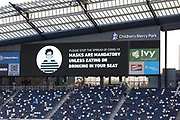 KANSAS CITY, KS - AUGUST 25: A video screen reminds fans that masks are required as part of COVID-19 safety precautions during an MLS match between the Houston Dynamo and Sporting Kansas City on August 25, 2020 at Children's Mercy Park in Kansas City, KS.  (Photo by Scott Winters/Icon Sportswire)