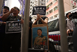 October 1, 2018 - Hong Kong, CHINA - Pro-Hong Kong independence supporters display a caricaturized image of Chinese Communist Chairman, Xi Jin-ping as dictator Adolf Hitler during annual anti-China rally organized by pro-democracy camps on the national day. Oct-1,2018 Hong Kong.ZUMA/Liau Chung-ren (Credit Image: © Liau Chung-ren/ZUMA Wire)