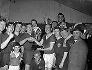 24/04/1960<br /> 04/24/1960<br /> 24 April 1960<br /> Soccer, F.A.I. Cup Final: Shelbourne v Cork Hibernians at Dalymount Park, Dublin. Charlie Tully(Cork Hibs.) congratulates Tony Dunne the Shels captain on the win.