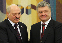 July 21, 2017 - Kiev, Ukraine - President of the Republic of Belarus Alexander Lukashenko, on the left, and Ukrainian President Petro Poroshenko, on the right, talking during an official meeting in Kiev. Ukraine, Friday, July 21, 2017  (Credit Image: © Danil Shamkin/NurPhoto via ZUMA Press)