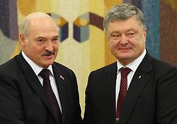July 21, 2017 - Kiev, Ukraine - President of the Republic of Belarus Alexander Lukashenko, on the left, and Ukrainian President Petro Poroshenko, on the right, talking during an official meeting in Kiev. Ukraine, Friday, July 21, 2017  (Credit Image: © Danil Shamkin/NurPhoto via ZUMA Press)