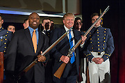 Billionaire and GOP Presidential hopeful Donald Trump and Senator Tim Scott hold replica flintlock rifles award by cadets during the Republican Society Patriot Dinner at the Citadel Military College February 22, 2015 in Charleston, South Carolina. Trump and Senator Tim Scott were honored at the annual event.