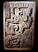 Yaxchilan lintel 15Maya, Late Classic period (AD 600-900)From Yaxchilán, Mexico. A serpent apparition from a Maya temple. limestone lintel, one of a series of three panels commissioned by Bird Jaguar IV for Structure 21 at Yaxchilán and was once set above the left (south-east) doorway of the central chamber. The lintel shows one of Bird Jaguar's wives, Lady Wak Tuun, during a bloodletting rite. She is carrying a basket with the paraphernalia used for auto-sacrifice: a stingray spine, a rope and bloodied paper. The Vision Serpent appears before her, springing from a bowl, which also contains strips of bark-paper.