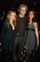 Left to right, JEANNE MARINE, BOB GELDOF and JOSS STONE at a Black, White and Gold party to celebrate the December 'Party' issue of Harper's Bazaar featuring the 'Going Out' Guide in association with Moet & Chandon  held at Ronnie Scotts, 47 Frith Street, London on 16th November 2006.<br />
