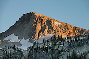 Eagle Cap seen from Mirror Lake at sunset. Backback to Mirror Lake in Eagle Cap Wilderness,  Wallowa–Whitman National Forest, Wallowa Mountains, Columbia Plateau, northeastern Oregon, USA. Hike 7.3 miles from Two Pan Trailhead (5600 ft) up East Lostine River to camp at popular Mirror Lake (7606 ft). Day hike to Glacier Lake via Glacier Pass (6 miles round trip, 1200 ft gain). Backpack out 8.7 miles via Carper Pass, Minam Lake and West Fork Lostine. From September 11-13, 2016 Carol and I walked 22 miles in 3 days.