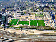 Nederland, Noord-Holland, Amsterdam; 17-04-2021; zicht op de Zuidas en Buitenveldert, inclusief de velden van AFC (Amsterdamsche Football Club). Rechts de Beethovenstraat.  Deelgebied Ravel. Ring A10 in de voorgrond, evenals de metrolijn en spoorlijnen. <br /> View of the Zuidas, with the soccer grounds of AFC (Amsterdam Football Club). Right the Beethovenstraat. Ravel sub-area.<br /> <br /> luchtfoto (toeslag op standaard tarieven);<br /> aerial photo (additional fee required)<br /> copyright © 2021 foto/photo Siebe Swart