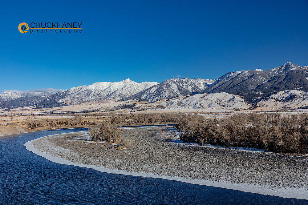 The Yellowstone River in winter with Absaroka Mountains in Paradise Valley, Montana, USA