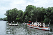 """Henley on Thames, United Kingdom, 23rd June 2018, Saturday,   """"Henley Women's Regatta"""",  view, Umpires , launch, umpire, with  """"Red Flag"""", raised, """"start of a heat"""" of the, """"women's single sculls"""", Henley Reach, River Thames, England, © Peter SPURRIER"""