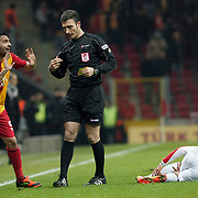 Referee's Ozgur Yankaya show the yellow card to Galatasaray's Engin Baytar (L) during their Turkish Super League soccer match Galatasaray between Kayserispor at the TT Arena at Seyrantepe in Istanbul Turkey on Saturday, 11 February 2012. Photo by TURKPIX