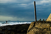 Body Boarder waiting to enter the surf on a stormy morning. Cowrie Hole, Newcastle, Eastern Australia Coast