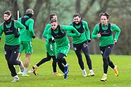 Scott Allan (#23) of Hibernian FC (right) runs with his team mates during the Hibernian press conference and training session at Hibernian Training Centre, Ormiston, Scotland on 18 December 2020.