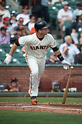 San Francisco Giants first baseman Buster Posey (28) runs out a sacrifice fly against the Colorado Rockies at AT&T Park in San Francisco, California, on September 20, 2017. (Stan Olszewski/Special to S.F. Examiner)