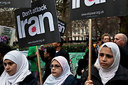 Muslim girls protest with their placards. Stop The War Coalition rally outside the US Embassy in London. Scuffles broke out during the protest, as opposite sides of the arguement shouted each other down. The protest is in response to inflamatory language being used by the US and UK concerning Iran and Syria. Free Iran supporters were came in strong numbers, to listen to speakers.