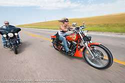 Calvin and Jodie Weiss ride their Harley-Davidsons Softail back to Sturgis on the annual Michael Lichter - Sugar Bear Ride hosted by Jay Allen from the Easyriders Saloon during the Sturgis Black Hills Motorcycle Rally. SD, USA. Sunday, August 3, 2014. Photography ©2014 Michael Lichter.