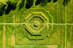 Stirling, Scotland, UK. 6 May 2020. Aerial view of 2 visitors on The King's Knot garden in Stirling with it's octagonal stepped mound or knot. It was probably laid out in 1627-8 by William Watts. Iain Masterton/Alamy Live News
