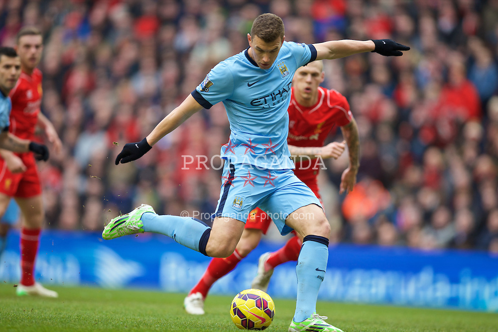 LIVERPOOL, ENGLAND - Sunday, March 1, 2015: Manchester City's Edin Dzeko scores the first equalising goal against Liverpool to level the score at 1-1 during the Premier League match at Anfield. (Pic by David Rawcliffe/Propaganda)