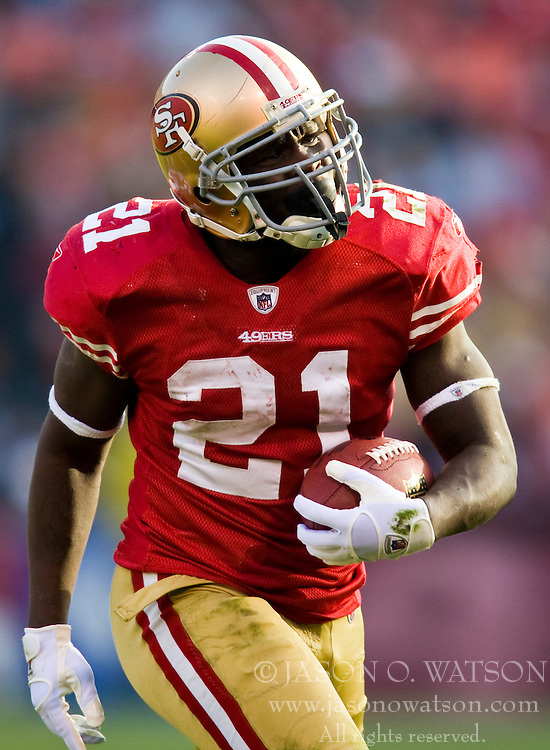 Dec 27, 2009; San Francisco, CA, USA;  San Francisco 49ers running back Frank Gore (21) during the third quarter against the Detroit Lions at Candlestick Park. San Francisco defeated Detroit 20-6.