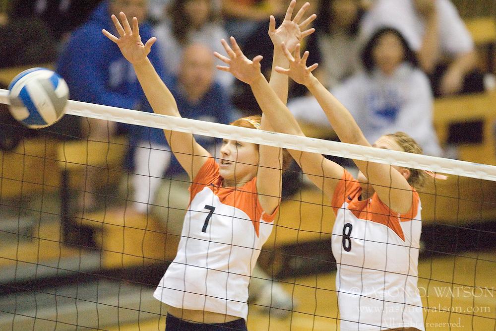 Virginia Cavaliers OH Lindsay Osco (7)..Virginia Cavaliers M Shannon Davis (8)..The Virginia Cavaliers Volleyball Team fell to the Duke Blue Devils three games to none on November 16, 2006 at Memorial Gymnasium in Charlottesville, VA...