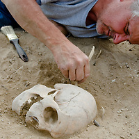 Smithsonian archaeologist & forensics specialist, Dr. Bruno Frohlich, unearths a bronze-age skeleton at a site above the Delger River near Muren, Mongolia. The  skeleton may be 2700+ years old.