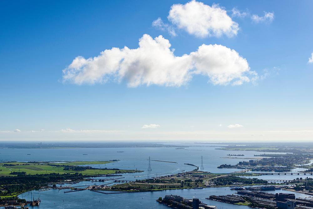Nederland, Noord-Holland, Amsterdam, 27-09-2015; Zeeburg, zicht op Zeeburgeiland en IJburg, Buiten-IJ. Almere aan de horizon.<br /> Ring A10 en Zeeburgertunnel, Buiten-IJ en Nieuwe Diep.<br /> <br /> View of East of Amsterdam, and the former Eastern Docklands and the IJ.<br /> luchtfoto (toeslag op standard tarieven);<br /> aerial photo (additional fee required);<br /> copyright foto/photo Siebe Swart