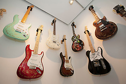 © licensed to London News Pictures. London, UK 13/08/2012. Guitars which have been used by Ronnie Wood shown at the 'A Major Retrospective Of 50 Years Of Rock And Roll' exhibition in central London.  Photo credit: Tolga Akmen/LNP