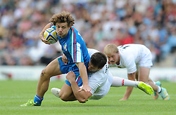 Luigi Niccolo Fadalti of Italy is challenged by Charlie Hayter of England - Photo mandatory by-line: Dougie Allward/JMP - Mobile: 07966 386802 - 11/07/2015 - SPORT - Rugby - Exeter - Sandy Park - European Grand Prix 7s