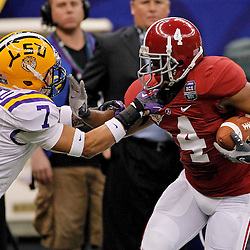 Jan 9, 2012; New Orleans, LA, USA; LSU Tigers cornerback Tyrann Mathieu (7) tackles Alabama Crimson Tide wide receiver Marquis Maze (4)during the first half of the 2012 BCS National Championship game at the Mercedes-Benz Superdome.  Mandatory Credit: Derick E. Hingle-US PRESSWIRE