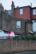 A giant inflatable Santa Claus towers over a garden wall on the 10th December 2018 in South London in the United Kingdom.