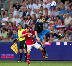 26.05.2012, Ullevaal Stadion, Oslo, NOR, UEFA EURO 2012, Testspiel, Norwegen vs England, im Bild England's Leighton Baines (Everton) in action against Norway's Tarik Elyounoussi (Fredrikstad) during the Preparation Game for the UEFA Euro 2012 betweeen Norway and England at the Ullevaal Stadium, Oslo, Norway on 2012/05/26. EXPA Pictures © 2012, PhotoCredit: EXPA/ Propagandaphoto/ Vegard Grott..***** ATTENTION - OUT OF ENG, GBR, UK *****