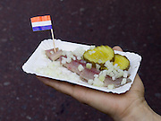 In the Netherlands herring is eaten raw with onions and this is considered a delicacy