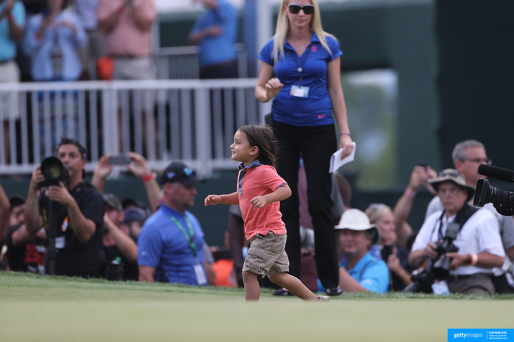 Dash runs out to greet his dad Jason Day, Australia, after winning the The Barclays Golf Tournament by six shots at The Plainfield Country Club, Edison, New Jersey, USA. 30th August 2015. Photo Tim Clayton