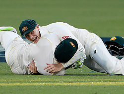 England V Australia at the Gabba. 23 Nov 2017 Pictured: Australia Captain Steve Smith crashes into wicket keeper Tim Paine on Ali Moeen's first delivery from Pat Cummings. Photo credit: MEGA TheMegaAgency.com +1 888 505 6342