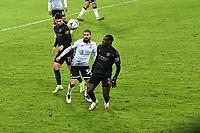 Football - 2020 / 2021 Emirates FA Cup - Round Five - Swansea City vs Manchester City - Liberty Stadium<br /> <br /> Kieron Freeman OF Swansea City Benjamin Mendy OF Manchester City