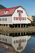 The Sons of Norway Hall Fedrelandet Lodge reflected on Hammer Slough in Petersburg, Mitkof Island, Alaska. Petersburg settled by Norwegian immigrant Peter Buschmann is known as Little Norway due to the high percentage of people of Scandinavian origin.
