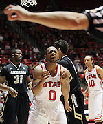 Utah guard Chris Hines (0) pleads with an official after being charged with a foul during the second half of an NCAA college basketball game against Colorado, Saturday, Feb. 18, 2012, in Salt Lake City. Colorado beat Utah 55-48. Also pictured is Colorado guard Jeremy Adams (31) and Utah forward Dijon Farr (10). (AP Photo/Colin E Braley).