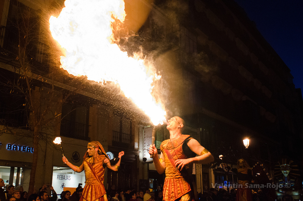 Man dressed as an ancient Egypcian spitting out fire, they are part of the Kull D'Sac Theatre Company.