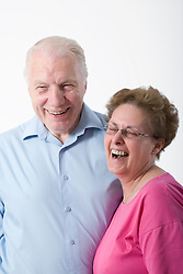 Portrait of an older couple laughing,